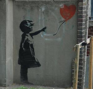 Banksy girl with lost baloon