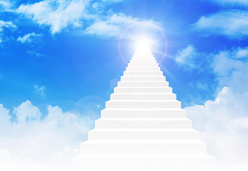 Staircase leading into heavenly clouds and sky