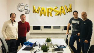 Photograph of Adam Otto (from left), Piotr Perzyna, and Rafal Malanij opened Container Solutions' Warsaw office with CS' chief operating officer Fahd Ekadioin.