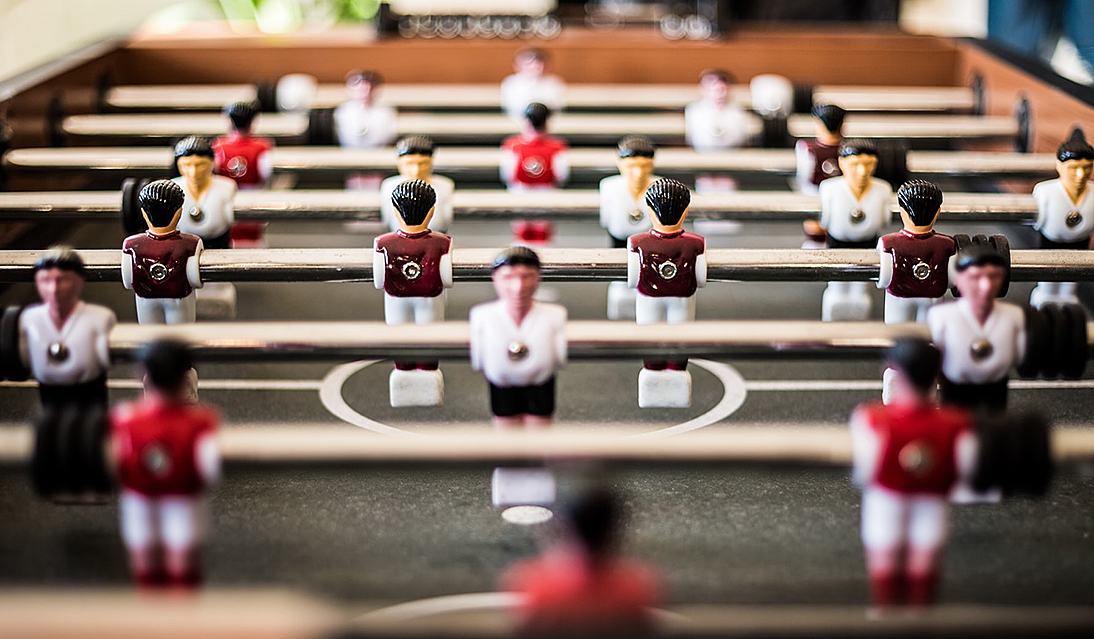 foosball table, with players spaced far apart