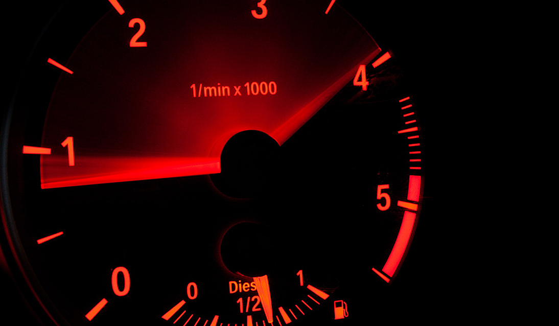 vehicle gauge in black and red